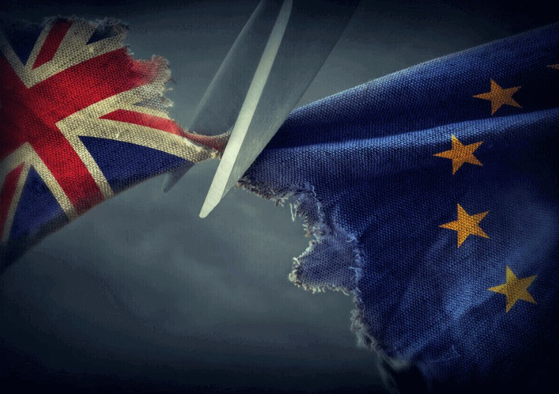 Brexit image of UK and EU flag being cut