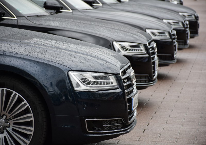 Five black audi cars in a row