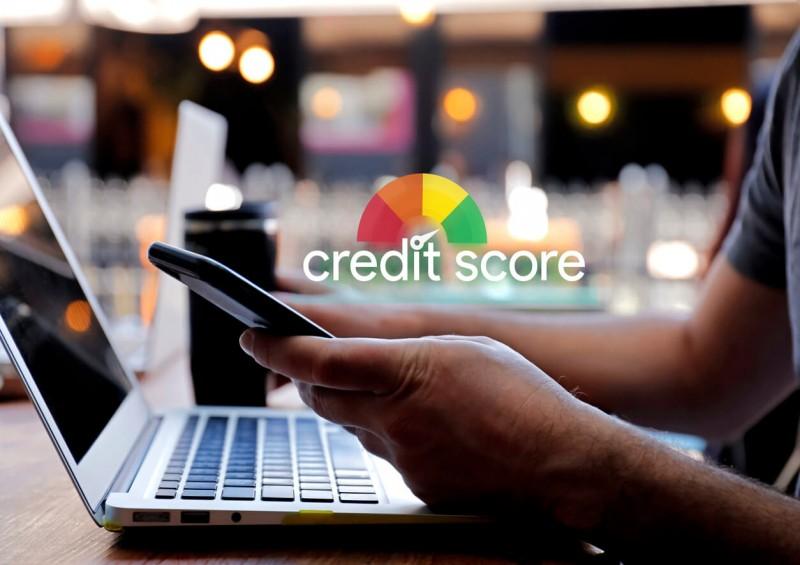 Man checking his credit score on phone