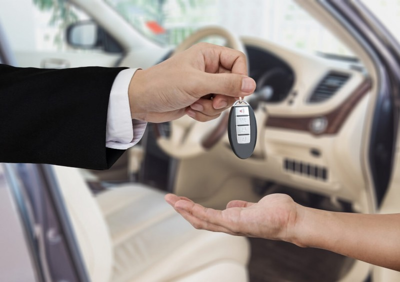 Man handing over car keys