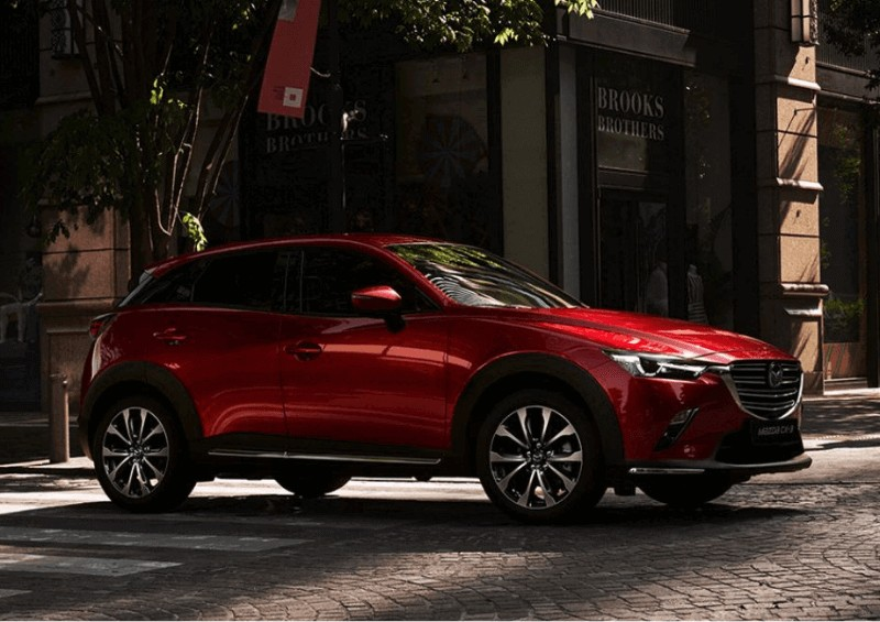 Side view of the red Mazda CX 3