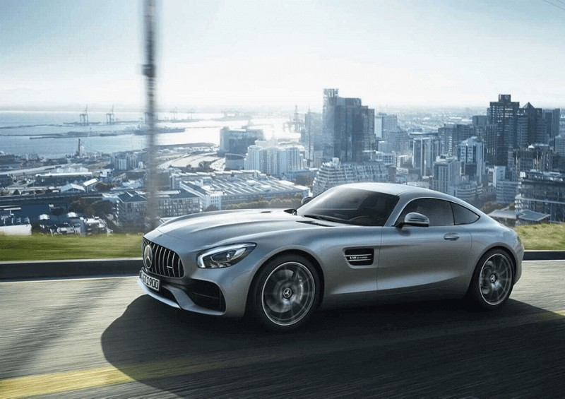 Silver Mercedes GT with city in background