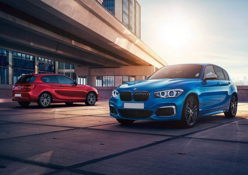 Two BMW 1 Series cars in red and blue
