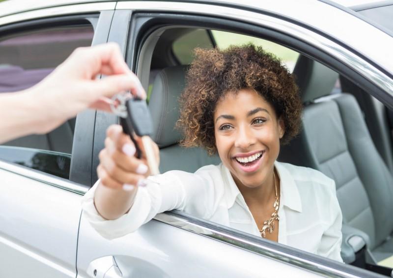 Young driver receiving new car keys