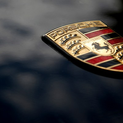 Close up of Porsche badge on car